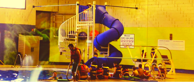 blue indoor slide with people