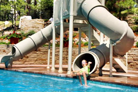 kid coming out of mariner water slide